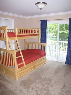 One of two similar bedrooms -- twin over a full bed with pullout trundle.