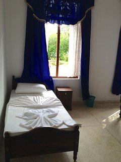 the blue bedroom (the single bed)