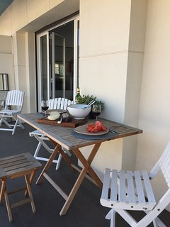 Balcony with dining table
