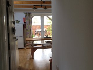 view from the hallway into the open plan kitchen lounge area