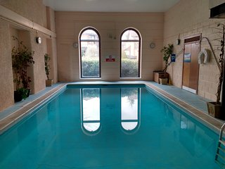 Two bedroom ground floor flat with shared indoor swimming pool