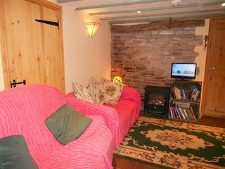 Cosy sitting room with double sofa bed