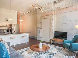 Stay with Lucky Savannah: Modern suite with exposed brick walls & wood floors