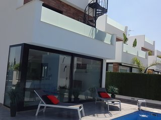New 4 Bed Villa  P/H Pool 6 seat Hot Tub, walk to beach 6.6km from airport