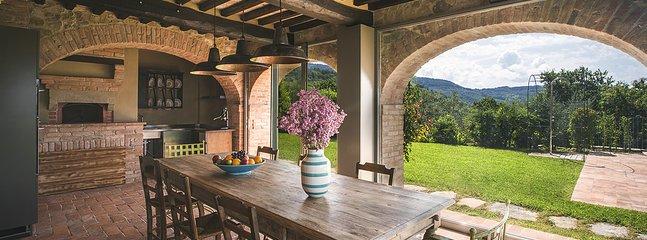 Villa Mandorlo's dining room + kitchen + wood oven