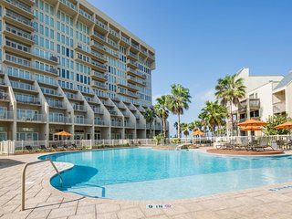 Two-level, dog-friendly, waterfront condo w/ shared pool, hot tub, gym