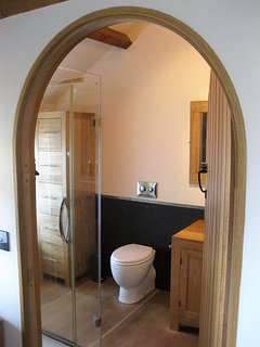 Through to the large and inviting luxury bathroom.
