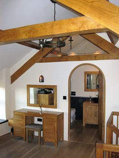 A view of the impressive oak trusses with double glazed unit separating bathroom.