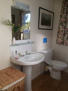 The upstairs bathroom with powerful shower over the bath, there is a further WC downstairs