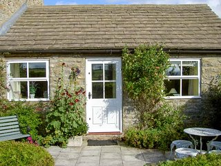CURLEW COTTAGE, all ground floor, patio with furniture, countryside views