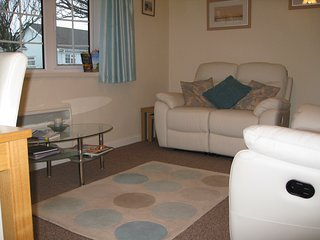 Gower Holiday Bungalow, immaculate,heated. Quiet village, pool, play areas,shop