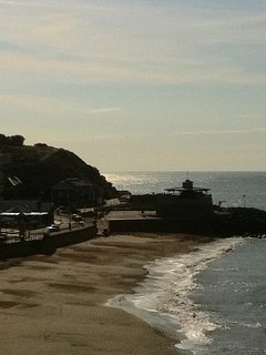 Ventnor beach & the bandstand, with a fantastic kids' paddling pool nearby, with an adjacent cafe.
