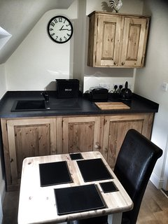 Handmade, fully fitted kitchen with oven, hob, microwave, dishwasher, washing machine