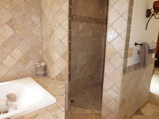 Master dual head shower completely tiled.