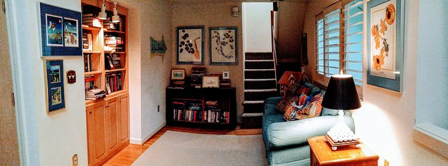 A TV or reading nook is on the second floor