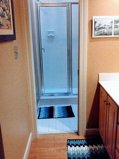 Tiled shower and toilet room are reached through vanity room--great privacy!