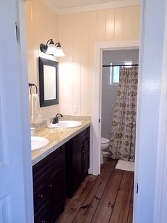 double vanity with private shower & toilet area