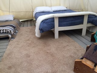 One futon to sleep two and up to 4 single air mattresses are available. Full deck inside.