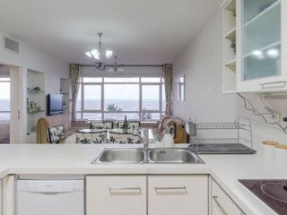 Large kitchen, lounge, TV and spectacular views