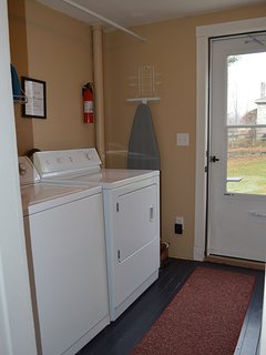Laundry Room with detergent and dryer sheets provided.