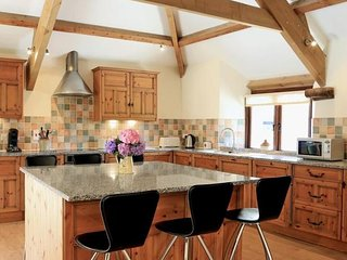 Large spacious kitchen with granite worktops and large island unit