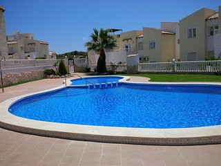 Basic 3 bed 1.5 bath Apartment minutes to Villamartin Plaza, community pool.