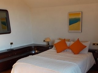Scirocco. Spacious bedroom with balcony and garden view