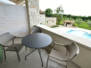 Vioet bedroom with mini kitchen on terrace pool view