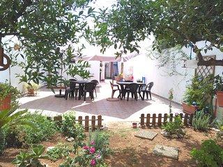 Villetta con giardino retrostante