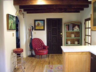 Main entry into house/kitchen off sun room. Looking at pantry door.
