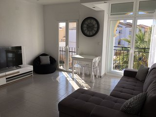 Newly refurbished Modern apartment set in beautiful gardens with large pool