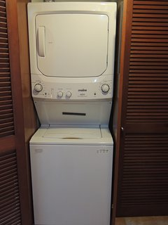 Washer and dryer located in the condo.
