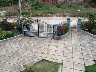partial view of paved area and gate