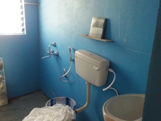 Each bathroom has a  mirror,wash basin,WC health faucet,shower and tap with hot water from a geyser
