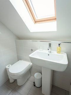 one of 2 shared family bathrooms