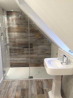 Upstairs bathroom her WC, wash hand basin, bath and walk-in shower.