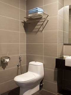 Modern toilet with basic toiletries