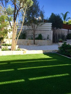 Private garden with dining area and sun lounges