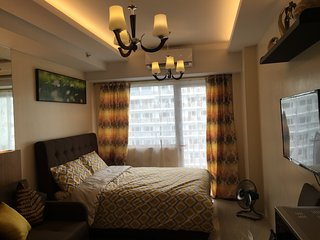 Shell Residence condo furnished for family of 4 with free wifi and cable TV