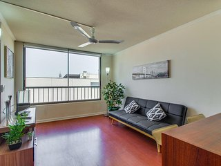 Dog-friendly condo with shared rooftop pool, great location, and skyline views!