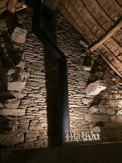 original stonework by the double height fire