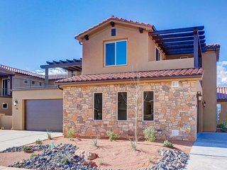 Modern, mountain view home with a patio, balcony, and shared pool & hot tub!