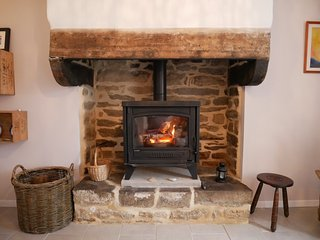 Traditional stone fire place with a wood burning stove.