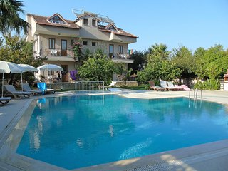 Beautiful family-run apartments in Dalyan with mountain views.