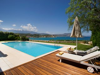 Ammos villa sea front steps from the beach -heated Pool -sleeps 6-7 people