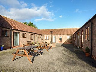 THE STABLE, all ground floor, open plan living, shared courtyard with picnic benches, Caistor, Ref 950234