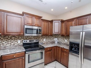 Huge townhome, new kitchen, across from beach, walk to attractions + restaurants