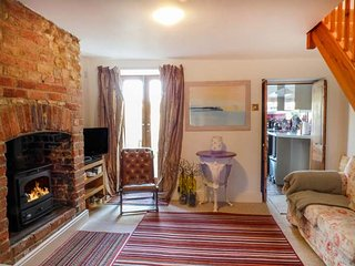 GRACE COTTAGE, woodburner, TV with Sky, WiFi, lawned garden, parking, in