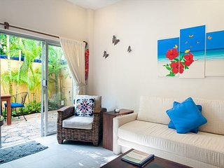 Modern, comfortable well appointed apartment with private garden courtyard.