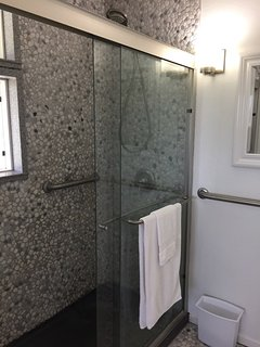 Master bath with tiled pebble shower